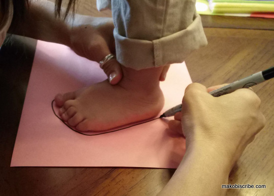 Making an Easter craft out of kids feet